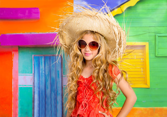 blond children happy tourist girl  beach hat and sunglasses