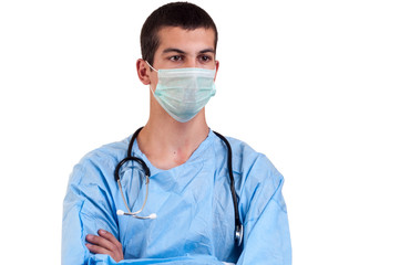 close up surgeon wearing blue scrubs with arms crossed
