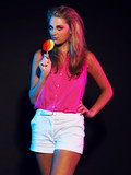 Retro 80s fashion disco girl with blonde hair and lollipop. Blac poster
