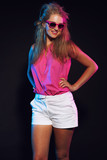 Sexy retro 80s fashion disco girl with long blonde hair and sung poster