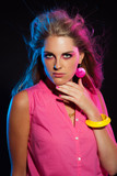 Beautiful retro 80s fashion disco girl with long blonde hair and poster