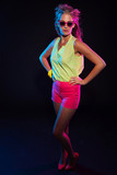 Sexy retro 80s fashion disco girl with long blonde hair and pink poster