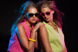 Two sexy retro 80s fashion girls with long blonde hair and sungl poster
