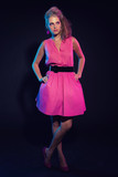 Naughty retro 80s fashion girl with pink dress and long blonde h poster