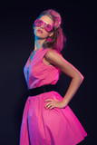 Sexy retro 80s fashion girl with pink dress and long blonde hair poster