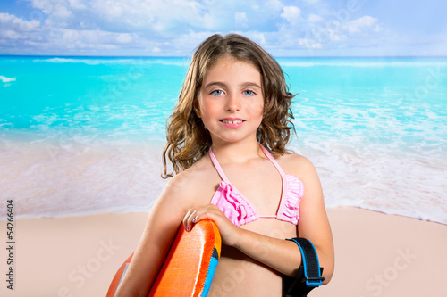 Children fashion surfer girl in tropical turquoise beach
