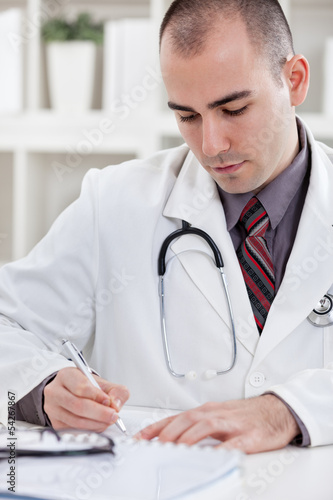 Writing a prescription or medical examination notes