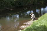Man fly fishing on River Lyd Devon UK