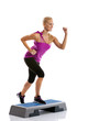 woman step aerobics exercise