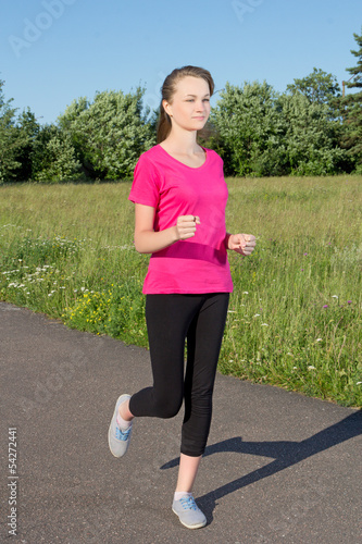 Slim woman running in park