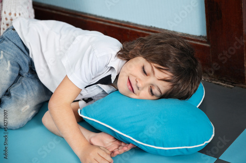Boy Lying On Heartshaped Pillow In Kindergarten
