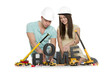 Home under construction: Joyful couple with machines building ho