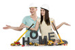 Home under construction: Happy couple with machines building hom