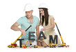 Forming a team: Joyous man and woman building team-word.