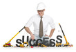 Working on success: Businessman buildinging success-word.