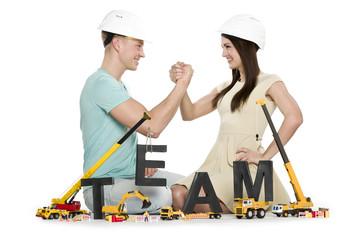 Forming a team: Joyful man and woman building team-word.