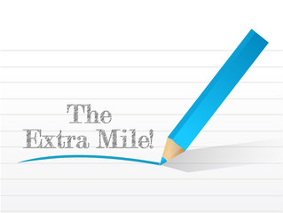 the extra mile sign written on a notepad