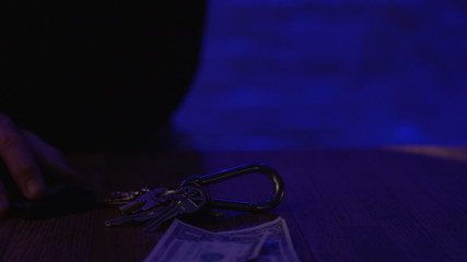 Keys and money laying around, horizontal