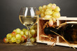 Wooden case with wine bottle, wineglass and grape