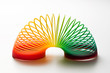Rainbow coloured slinky toy - 54275866