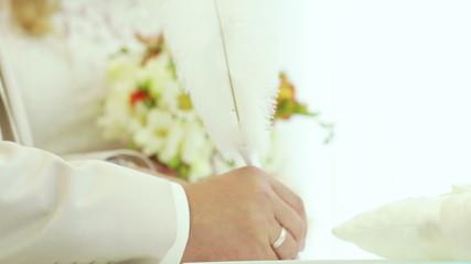 Newlyweds sign documents