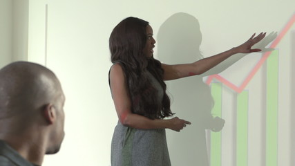 African American business woman presenting charts