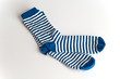 Blue and white striped socks on white background - 54277867