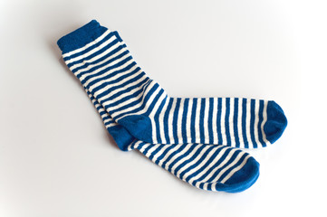 Blue and white striped socks on white background
