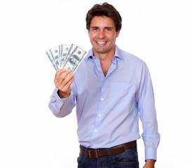 Smiling adult man holding cash dollars