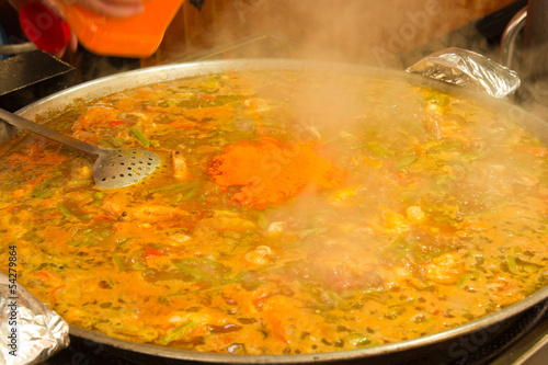 making traditional spanish paella
