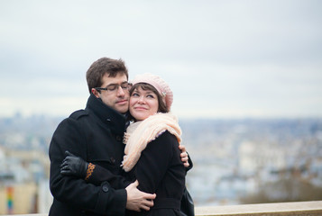 Dating couple hugging in Paris