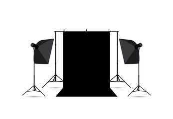 Two softboxes and black photo background isolated on white.