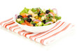 Greek salad in plate isolated on white
