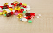 Assortment of pills, tablets and capsules on wooden table