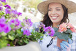 Content Young Adult Woman Wearing Hat Gardening Outdoors