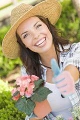 Smiling Young Adult Woman Wearing Hat Gardening Outdoors