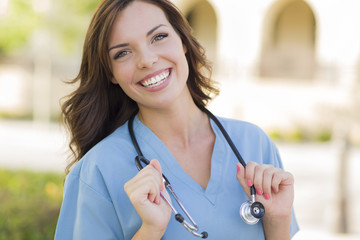 Smiling Young Adult Woman Doctor or Nurse Portrait Outside