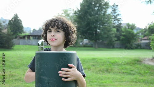Hispanic Child Drinking from a Water Fountain