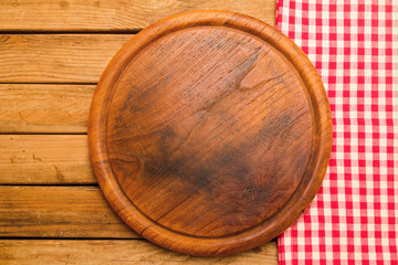 Bread board on wooden background with tablecloth