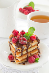 Waffles with raspberry, honey and chocolate.