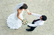 hand in hands. top view of loving bride and groom