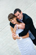 happy wedding couple standing and embracing