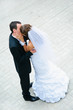 happy wedding couple standing, kissing and embracing