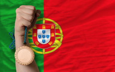 Bronze medal for sport and  national flag of portugal
