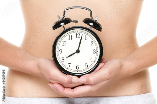 Biological clock ticking - woman holding watch