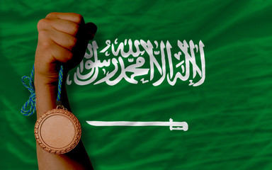 Bronze medal for sport and  national flag of  of saudi arabia