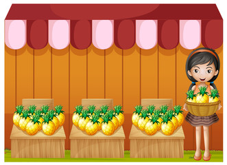 A girl selling pineapples