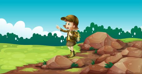 A female explorer near the rocks