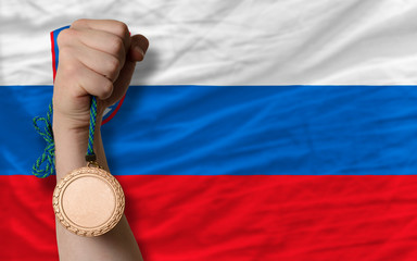 Bronze medal for sport and  national flag of slovenia
