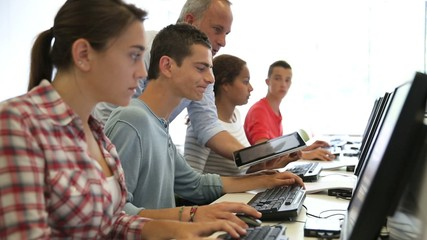Group of young people in computing class
